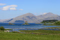 Jubilee bridge appin castle stalker scotland view from near port with the across loch laich at high tide to with loch linnhe Royalty Free Stock Images