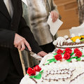 Jubilee cake cutting a man with the knife cut of a wedding Royalty Free Stock Photo