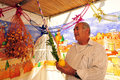 Judaism sukkot jewish holiday in israel sderot isr oct an orthodox jew blesses on the four species his family sukka on oct it s a Royalty Free Stock Images