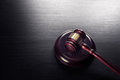 Judge gavel on a black wooden background Royalty Free Stock Photo