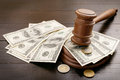 Judge gavel with dollars and euro cents Royalty Free Stock Photo