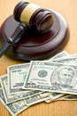 Judge gavel and dollars on wooden table Royalty Free Stock Image