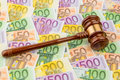 Judge gavel and euro banknotes symbolic photo for costs in court of law auctions Stock Photo