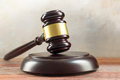Judge gavel and sound board on a wooden desk, justice symbol and