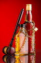 Judge gavel and whisky bottles composition Royalty Free Stock Photo