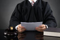Judge Reading Paper Royalty Free Stock Photo