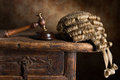Judge s court wig and hammer or gavel Royalty Free Stock Photo
