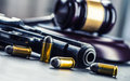 Judge s hammer gavel justice and gun justice and the judiciary in the unlawful use of of weapons judgment in murder Royalty Free Stock Photos