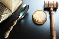 Judges Gavel, Magnifier And Old Book On The Black Table Royalty Free Stock Photo