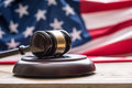 Judges wooden gavel with USA flag in the background. Symbol for jurisdiction Royalty Free Stock Photo
