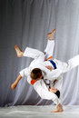 In judogi two athletes doing judo throws Royalty Free Stock Photo