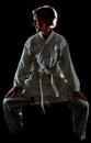 Judoka girl low key picture that illustrates judo with a female on a black background Royalty Free Stock Photo