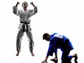 Judokas fighters fighting men silhouette two in on white background Stock Photos