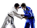 Judokas fighters fighting men silhouette two in on white background Royalty Free Stock Photo