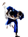 Judokas fighters fighting men silhouettes two in on white background Stock Photo