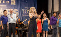"Judy mclane and cast sing the winner takes it all from mamma mia at ""stars in the alley "" a free outdoor concert produced by Stock Photo"