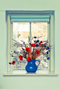 Jug of flowers fresh summer on a window sill Stock Photos