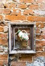 Jug in frame on brick wall Royalty Free Stock Photo