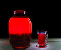 Jug and glass of cherry juice on a black background Royalty Free Stock Photo