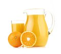 Jug glass of orange juice and orange fruits isolated on white Royalty Free Stock Photo
