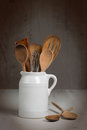 Jug of kitchen utensils including wooden spoons Stock Photography
