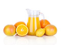 Jug of orange juice and citrus fruits  Royalty Free Stock Photography