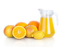 Jug of orange juice and citrus fruits Royalty Free Stock Image