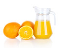 Jug of orange juice and orange fruits  Royalty Free Stock Photos
