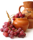 Jug and red grapes Royalty Free Stock Image
