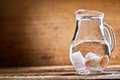 Jug of water with stones Royalty Free Stock Photo