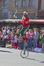 Juggler rides a unicycle in the asheville christmas parade north carolina usa november colorful dressed like an elf entertains Royalty Free Stock Photo