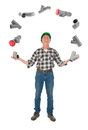 Juggling plumber with pvc tubes funny over white background Royalty Free Stock Photo