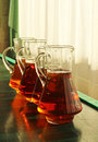 Jugs with apple juice four Royalty Free Stock Photography