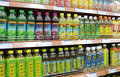 Juice and beverages in supermarket soft drinks china shelf Stock Photo