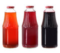 Juice bottles isolated on white Royalty Free Stock Image