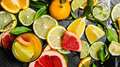 The juice from citrus fruits - grapefruit, orange, tangerine, lemon, lime in the glass. Royalty Free Stock Photo