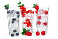 Juice with currant, raspberry, blueberry and ice Royalty Free Stock Photo