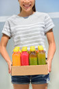 Juice detox cleanse diet with vegetable juicing raw and organic fruits and veggies fresh juices delivery woman drinks young Royalty Free Stock Images