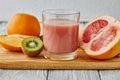 Juice of a grapefruit, kiwi and orange Royalty Free Stock Photo
