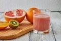 The juice of grapefruit, orange and kiwi Royalty Free Stock Photo