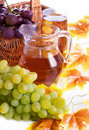 Juice in jug and autumn leaves grape Stock Photo