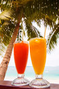 Juice on paradise beach two glasses of Stock Photos