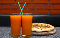 Juice and pizza two glasses of Royalty Free Stock Photo
