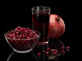 Juice and pomegranate fruits isolated on black Stock Image