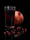 Juice and pomegranate fruits isolated on black Royalty Free Stock Photo