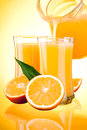 Juice to pour from pitcher, Oranges with leaves Stock Photo
