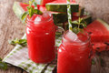 Juice of watermelon with ice and mint close up in a glass jar. Royalty Free Stock Photo