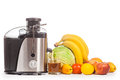 Juicer with fruit on a white background Stock Photos