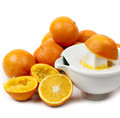 Juicing oranges on white Stock Image