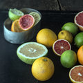 Juicing a selection of fresh citrus fruit Royalty Free Stock Photo